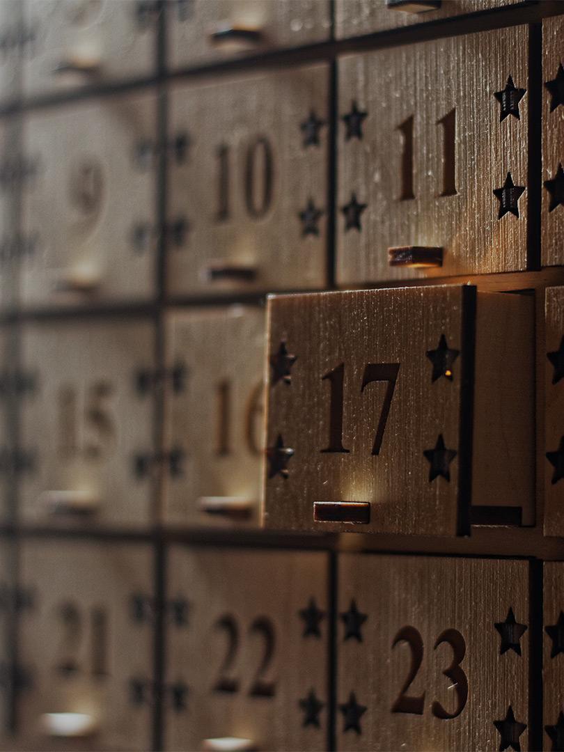 An advent calendar with a door open